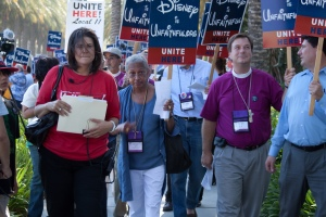 Episcopalians attending General Convention linked arms with hotel workers July 14 to march to the gates of Disneyland to demand economic justice for 2,300 Disney employees protesting a planned hike in the cost of their health insurance.  Thanks to our man on the ground Jim DeLa for this photo.