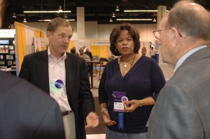Bishop Gayle E. Harris, who chairs the Church Pension Fund Legislative Committee, caucuses with Barton Jones (left), general counsel for Church Pension Group, and consultant Matthew Chew (right).