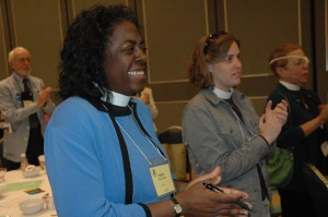 The Rev. Valerie Bailey Fisher enjoys the Episcopal Women's Caucus breakfast.