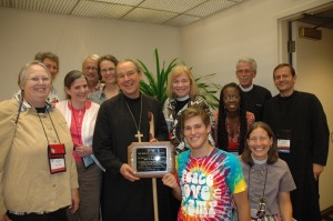 Massachusetts members celebrate Hero of Camping Ministries Award with Bishop Shaw (center left):  Becky Alden, Mally Lloyd, Helen Gordon, Bud Cederholm, Lallie Lloyd, Gale Davis Morris, Sam Gould, Karen Montagno, Rob Hensley (standing back), Jane Gould (kneeling front) and Brother Geoffrey Tristram, SSJE.